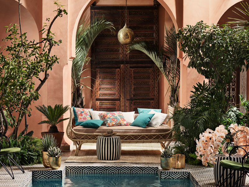 Planters and cushions in a tranquil Moroccan Riad